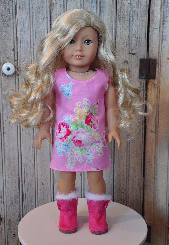 Use the Sunshine Dress PDF sewing pattern to make a short sleeved A line dress for your 18 inch doll like American Girl. Find this and many other PDF patterns to sew doll clothes in the OhSewKat etsy shop.