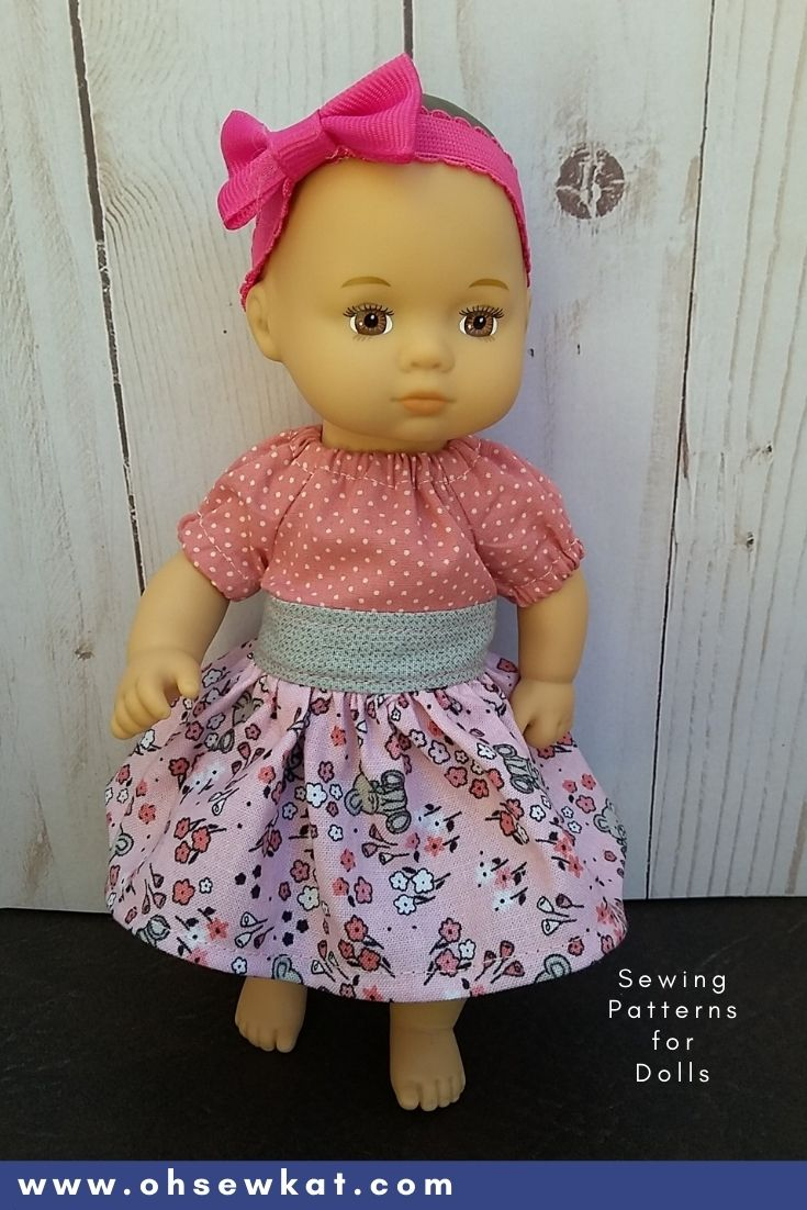 Sew for your 8 inch Caring for Baby Doll from American Girl. The Party Time Peasant Dress pattern is tiny but easy to sew with just a few scraps from OhSewKat. Find more PDF sewing patterns for dolls like 18 inch American Girl Dolls and Welliewishers.